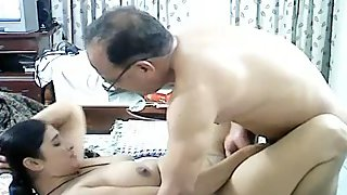 Uncle and aunty fucking in their bedroom without condom
