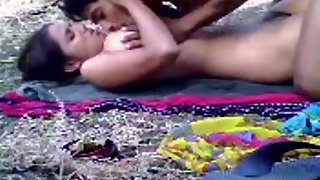 Cute Indian couple having sex in open