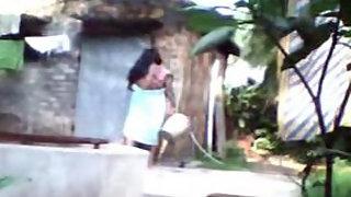 Desi wife taking shower in open air