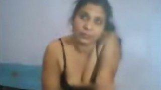 Aunty enjoying hot sex in their bedroom