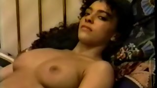 Sexy girl showing her boobs on bed