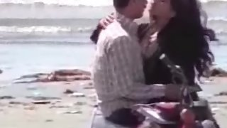 Young couple having a fun on see beach